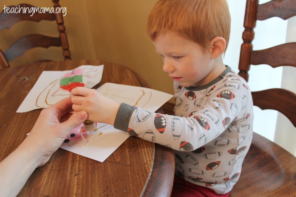 Using glitter glue- great for fine motor skills
