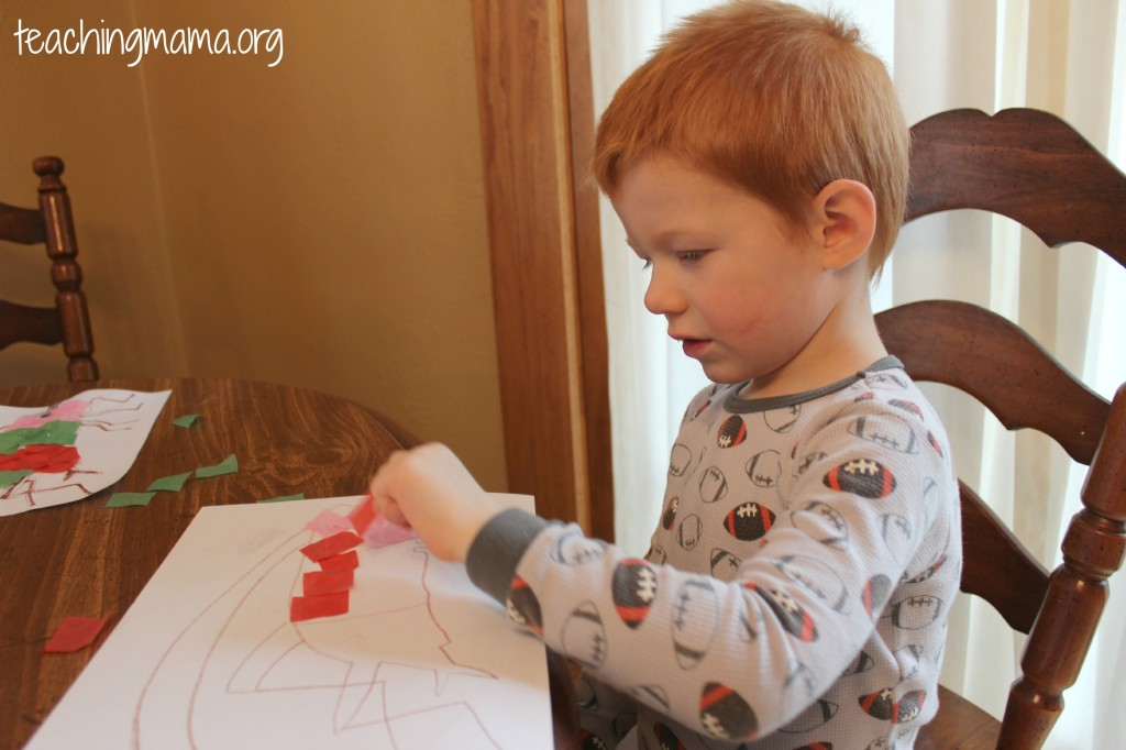 Laying down tissue paper- great for fine motor skills