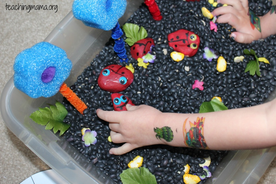playing with the sensory bin