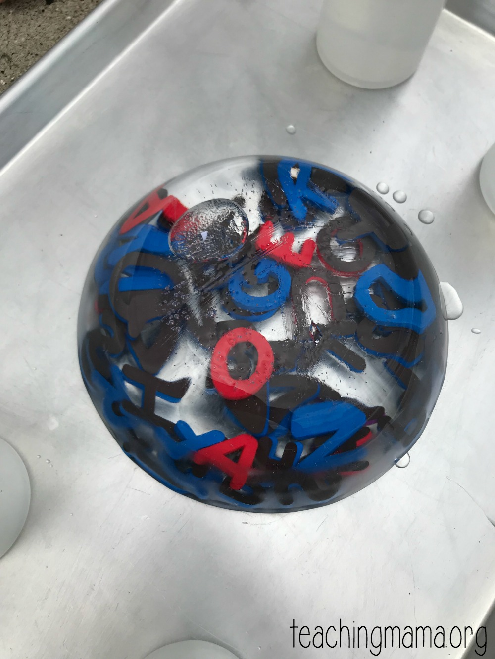 ice block with alphabet letters