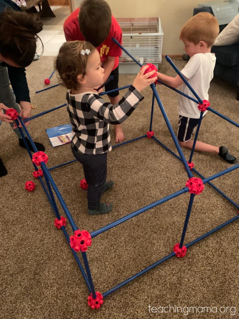 toddler building fort